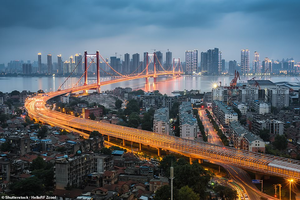The Yingwuzhou Bridge in Wuhan crosses the mammoth Yangtze River. Wuhan is the capital of Hubei Province and the most populated city in central China. There live about 10 million people