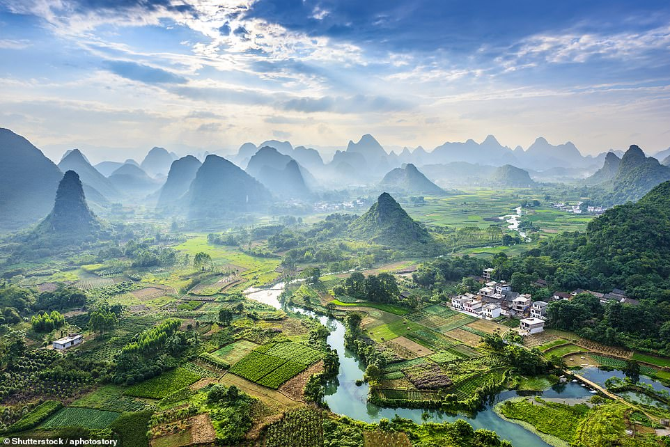 The Li River meanders around the karst mountains in Guilin. The Chinese consider the landscape in Guilin as one of the most beautiful in the world