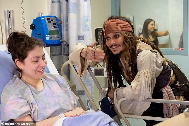Beattie added: 'I think Jack Sparrow will be his legacy. It's the only character he's played five times, it's the character he dresses up in to visit children in hospitals, it's what he'll be remembered for.' Pictured: Depp dressed up as Sparrow visiting children in Canada in 2017
