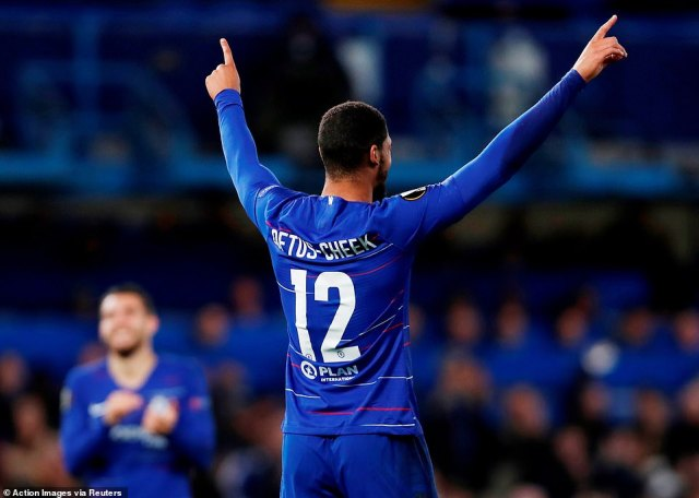 Loftus-Cheek raises his arms towards the crowd as he completes his hat-trick and gives Chelsea a three-goal lead