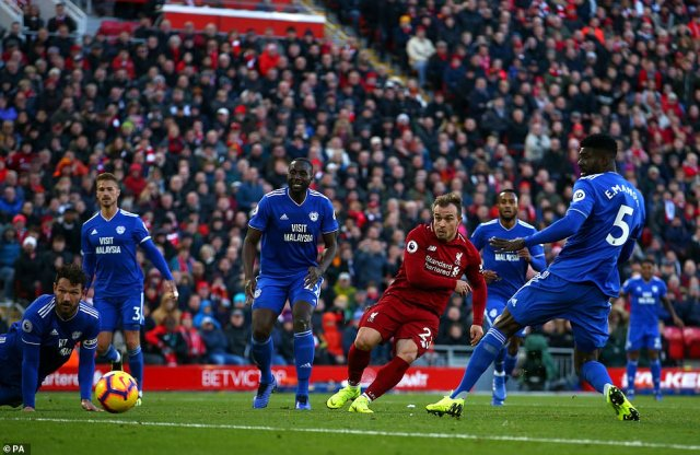 Xherdan Shaqiri makes space for himself in the Cardiff penalty area before slotting the ball into the bottom corner
