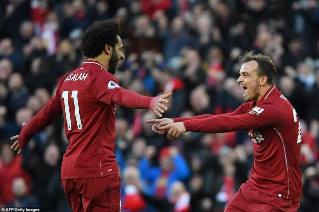 Xherdan Shaqiri celebrates with a delighted Mohamed Salah after latching onto the Egyptian's ball into the area