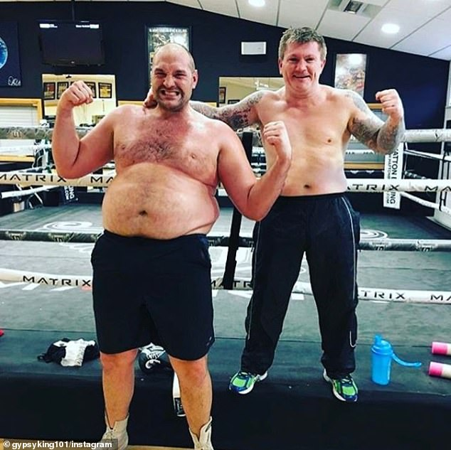 Fury, pictured with Ricky Hatton in November last year, ballooned to over 400lbs at one point