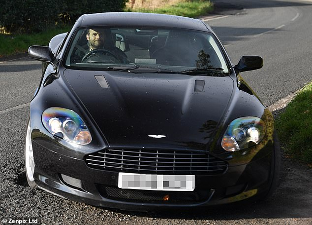 Black is clearly in the stars - Juan Mata drove a black Aston Martin