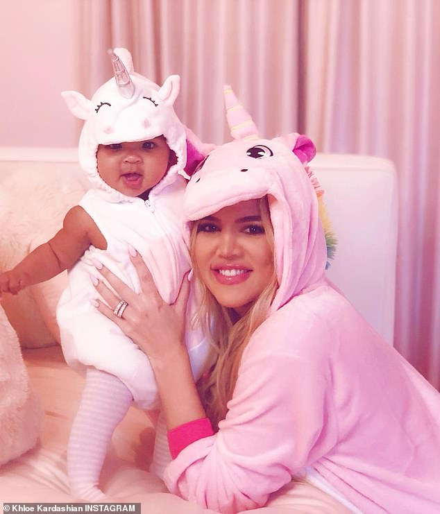 Baby's first Halloween:Khloe Kardashian wore a pink onesie as she posed with her daughter True who was in a unicorn outfit