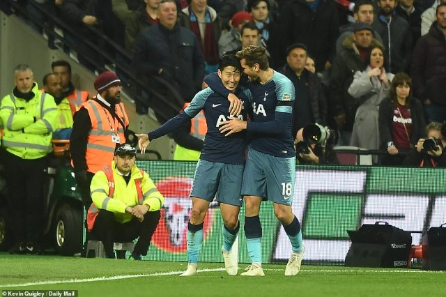 The South Korean forward is congratulated by team-mate Fernando Llorente after scoring the opening goal for Spurs