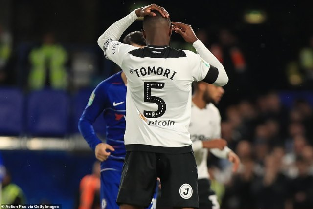 Defender Tomori holds his head after putting the ball into his own net against Chelsea at Stamford Bridge on Wednesday