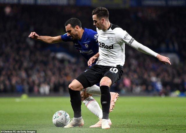 Derby's Tom Lawrence is challenged by Chelsea's Zappacosta during the Carabao Cup fixture at Stamford Bridge