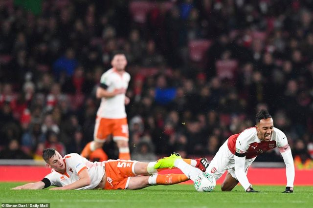 The Blackpool defender was punished for a scissor-like challenge as the Gabon attempted to break forward with the ball