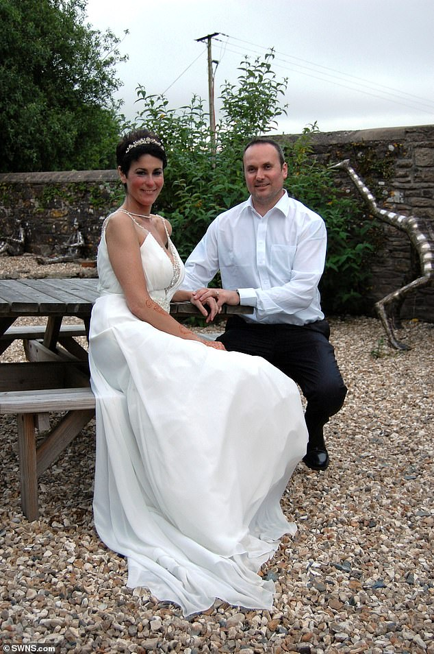 Oncology nurseLaura Harris died on Wednesday morning after a battle with bowel cancer. She is pictured on her wedding day in May last year with her husband Paul. He was by her side when his 'angel' passed away and has since posted a Facebook tribute to his 'soulmate'