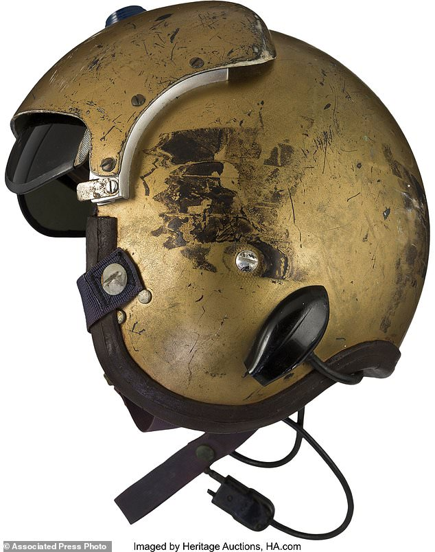 The golden headdress was a gift from Glenn - the first American circling the earth - to Matt Carpenter, the son of Scott Carpenter, who also belonged to the Mercury Seven Astronaut team
