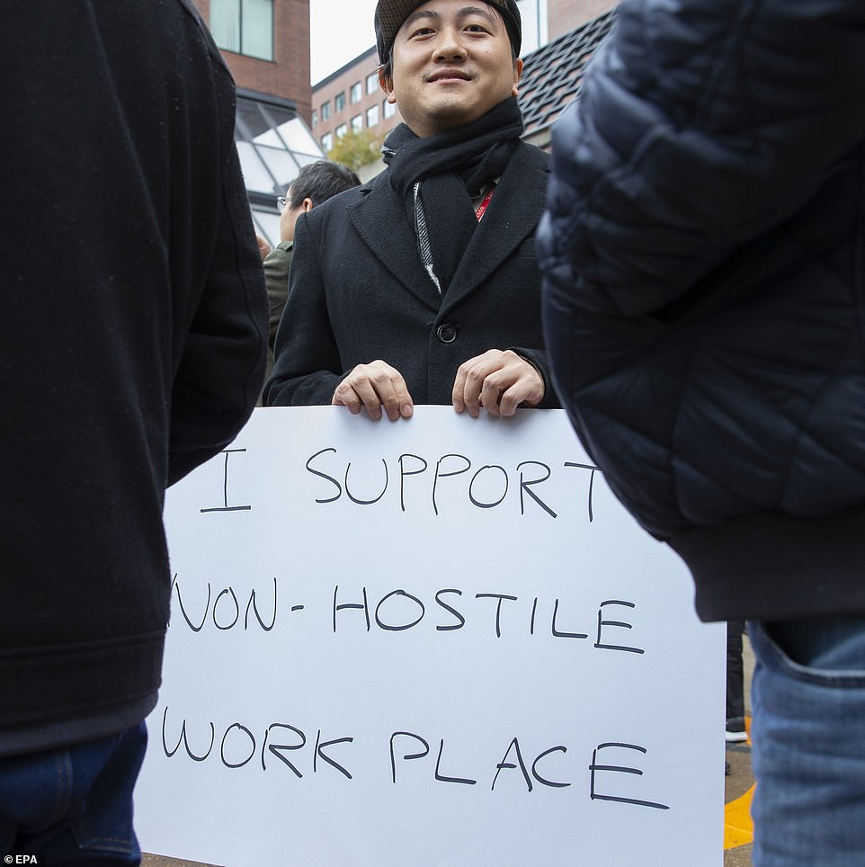 """A Google employee who went out in Cambridge, Massachusetts, has a sign saying """"I support a non-hostile workplace."""""""