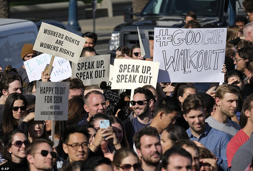 """A San Francisco protester held a sign saying """"Happy to give 90 million dollars, no sexual harassment required"""""""