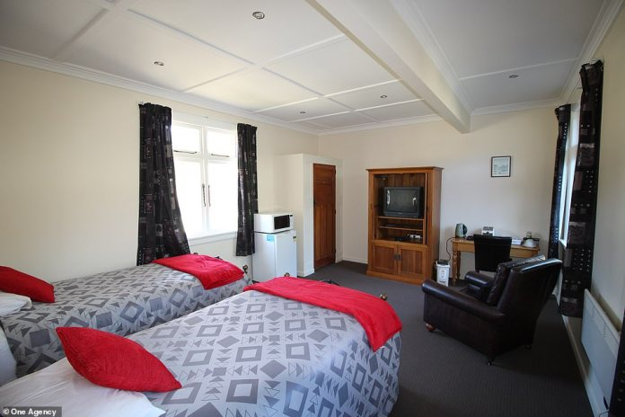 Potential buyers have told the agency that markets the village that they would like to convert it into a holiday resort or a winery. Pictured is one of the bedrooms in the main lodge