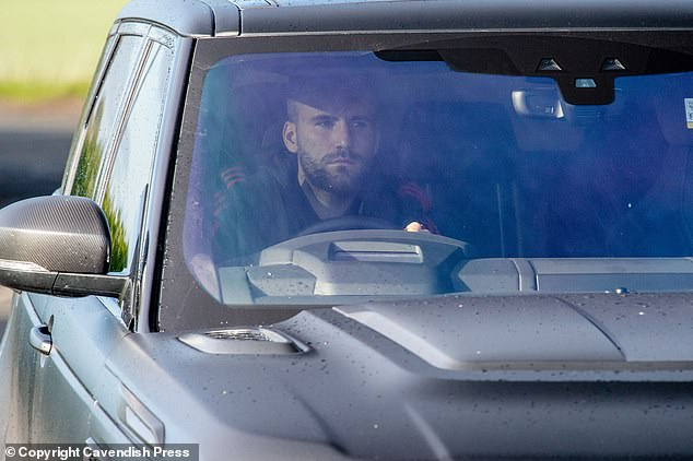 Manchester United defender Luke Shaw focuses on the road as he comes to training