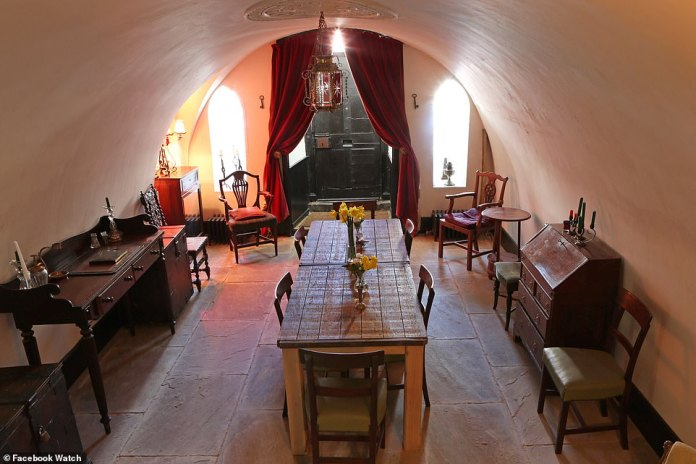 A view inside Hatch's Castle with an arched ceiling and a rustic stone-paved floor