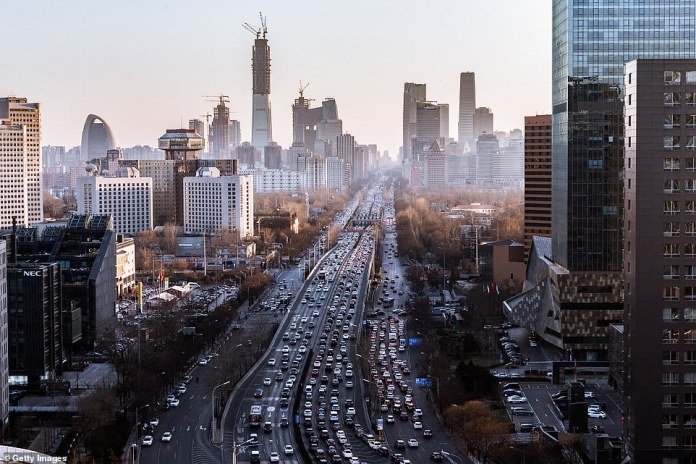 Cars drive along a highway through China's capital Beijing. Beijing's growing car ownership makes it one of the world's worst places for air pollution