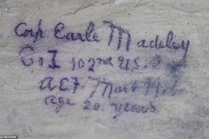 US corporal Earle Madeley of Plainville, Connecticut, wrote this barely legible message, which included his age of 20. In total, after 210 days of the First World War, 1,587 Yankee Division members were killed and 12,077 injured