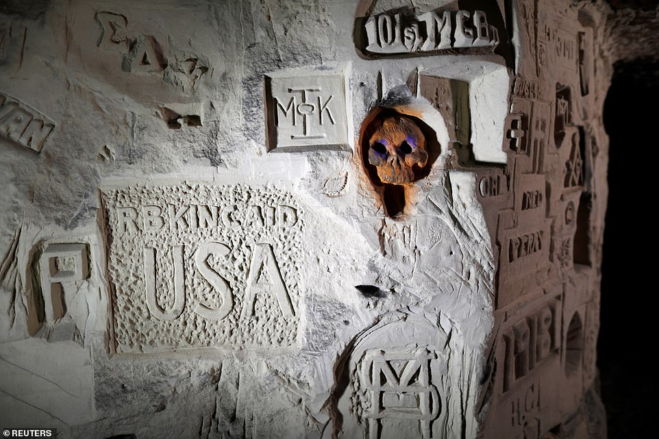 Among the 1,000 inscriptions discovered in the Froidmont quarry are carvings of American soldiers of the 26th Division