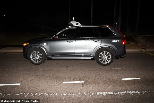 An Uber SUV after meeting a woman in Tempe, Ariz, on March 18, 2018. Just over eight months after one of his autonomous test vehicles shot dead a pedestrian in Arizona, Uber wants to continue testing on public roads.