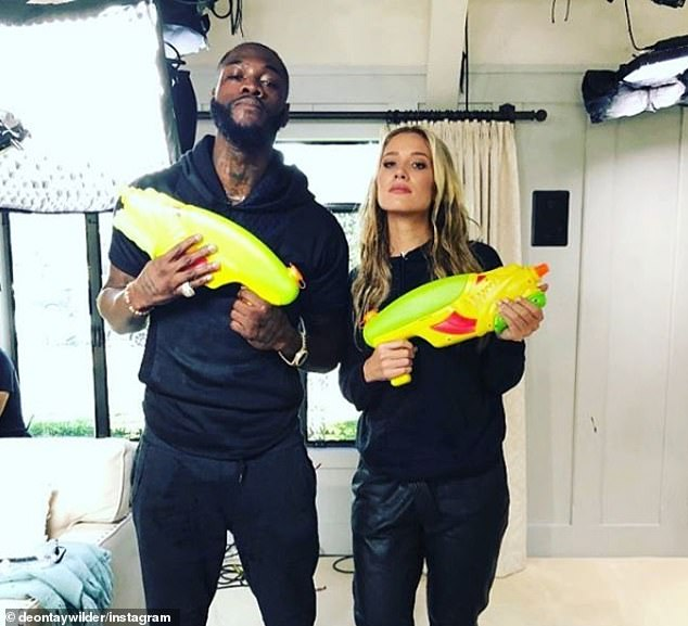 Wilder poses with a water gun after an interview to push his fight with Tyson Fury