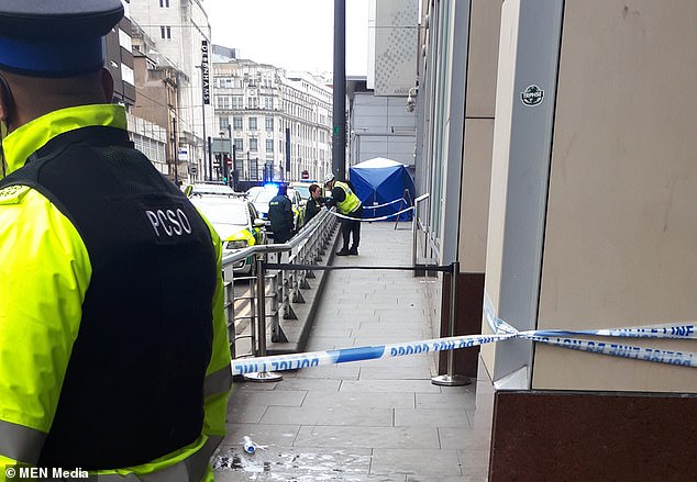 A woman has died after falling from the roof of Manchester's Arndale Centre in front of horrified shoppers. Pictured: police at the scene of the incident today