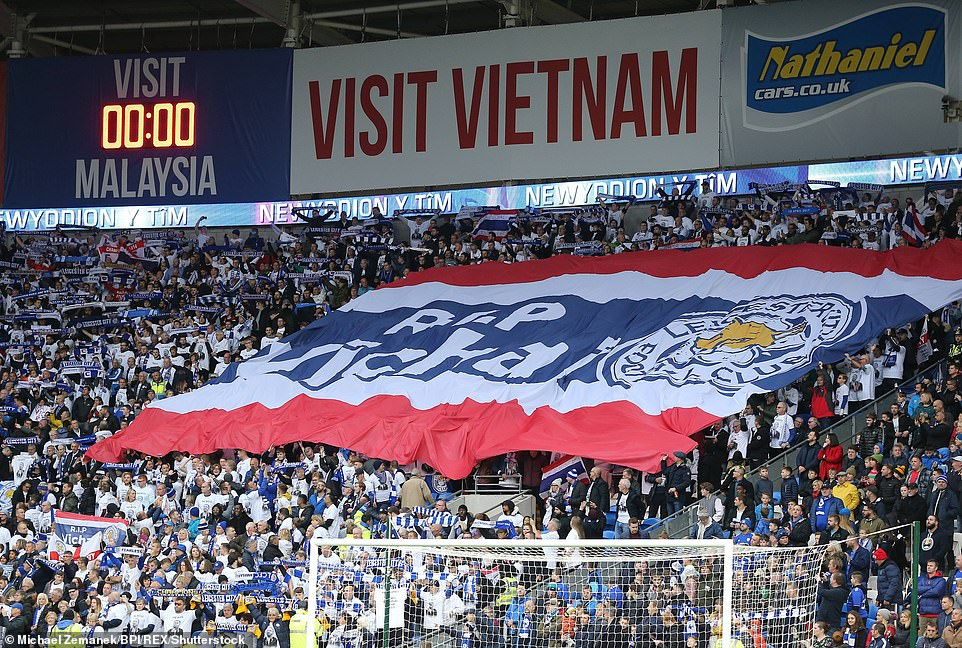 """The fans of Leicester drive before kicking through a huge banner with the inscription """"RIP Vichai"""" in the stadium"""