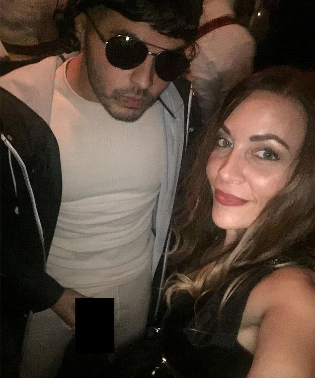 A photo surfaced of Detective Victor Falcon holding a prosthetic penis and posing with Sergeant Ann Marie Guerra at a Halloween bash two years ago. He says the photo was leaked to 'publicly shame and discredit' him