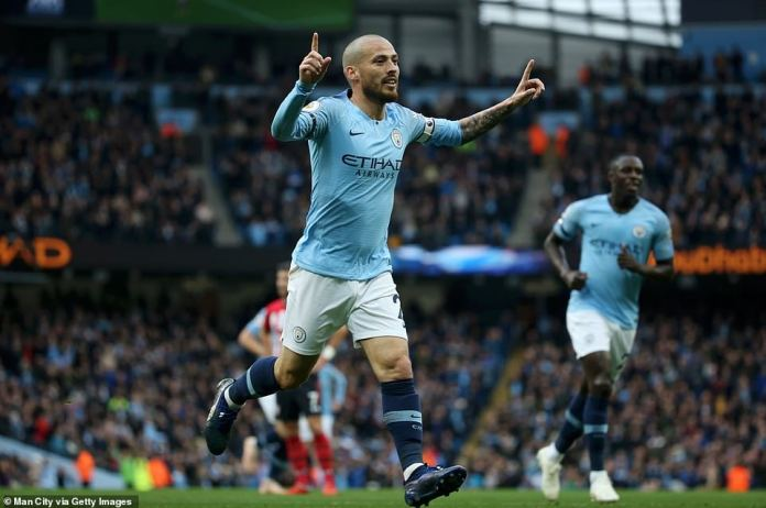 Midfielder David Silva is jubilant for his goal, scoring the opening goal of City in the 18th minute