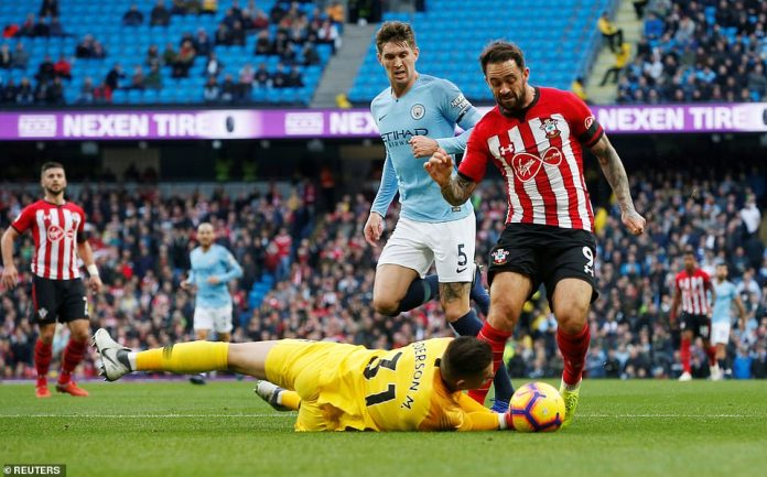 Southampton striker Danny Ings receives a penalty for being fouled by city goalkeeper Ederson
