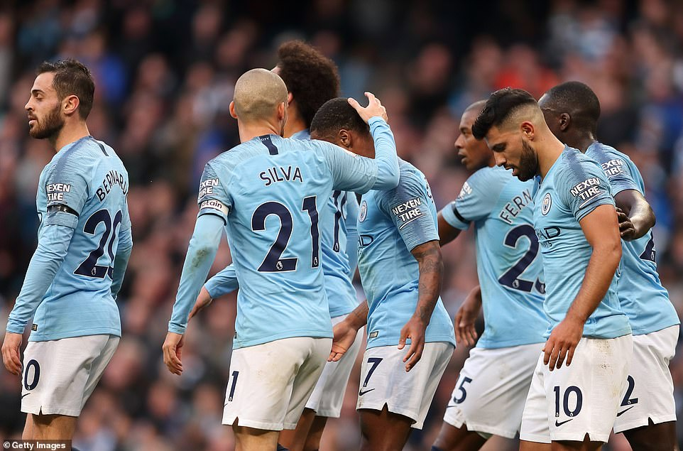 The city players celebrate after Sterling's goal was scored 4-1 against the Premier League leaders