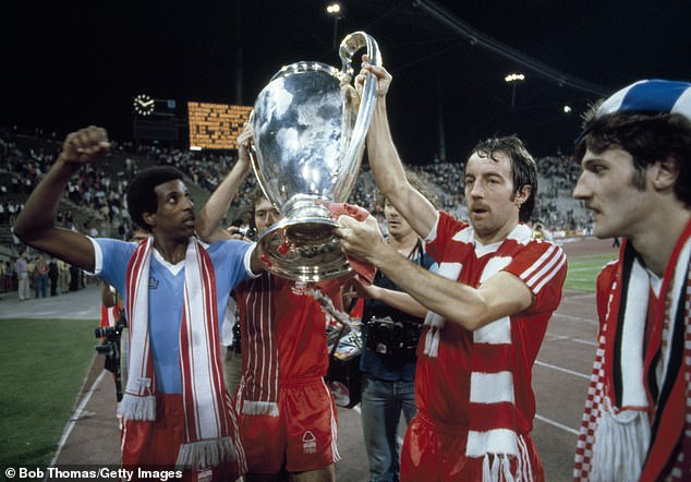 Viv Anderson and Clark lead the trophy after defeating Malmö to complete the fairy tale