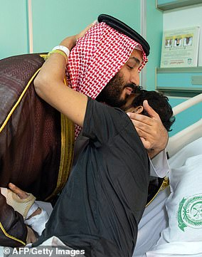 Saudi Crown Prince Mohammed bin Salman (left) visiting a wounded soldier at the Riyadh Military Hospital