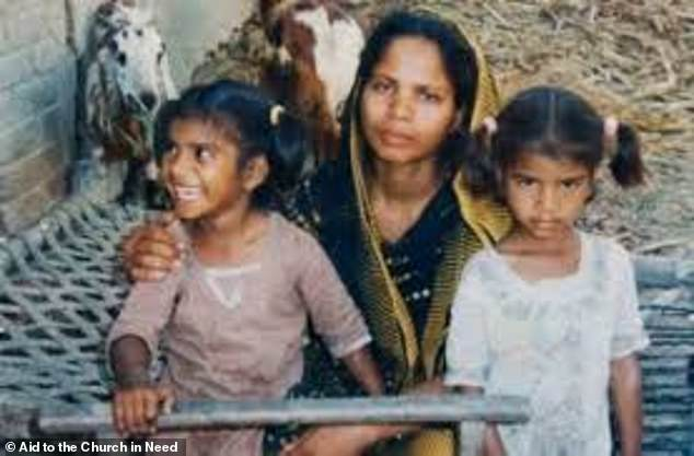 Asia Bibi is seen with her two youngest children Eisham, left, and her sister Esha, right, who has learning difficulties - now aged 18 and 17