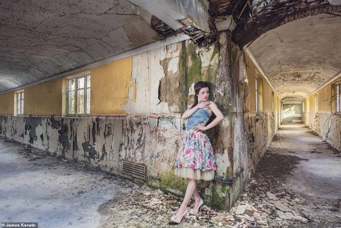 Jade in 2015 modeling a floral dress as she leans against the wall in Severalls' deserted asylum in Colchester, Essex