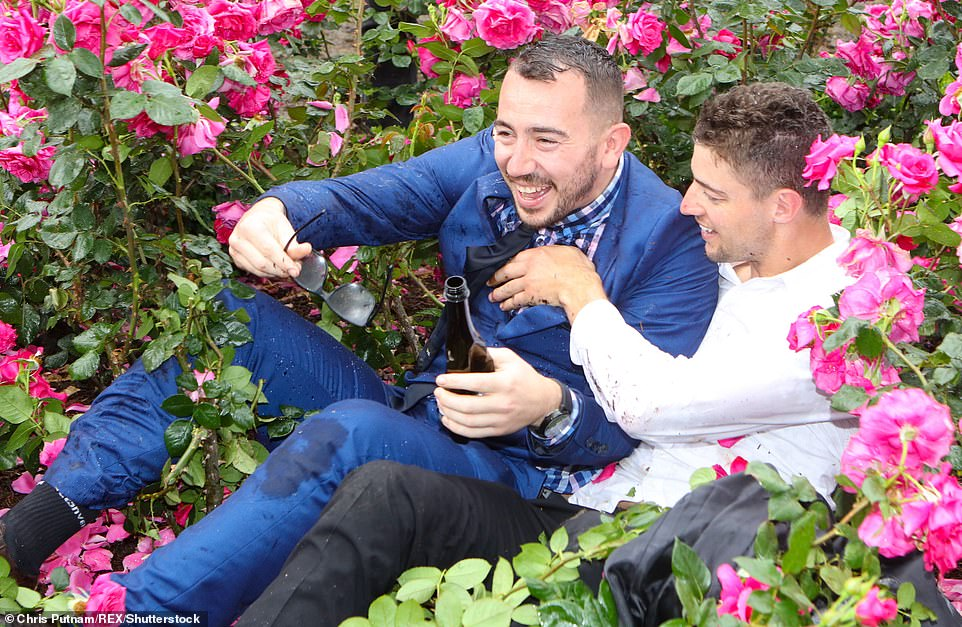 Two blokes found themselves in a prickly situation after falling into a rosebush after the race