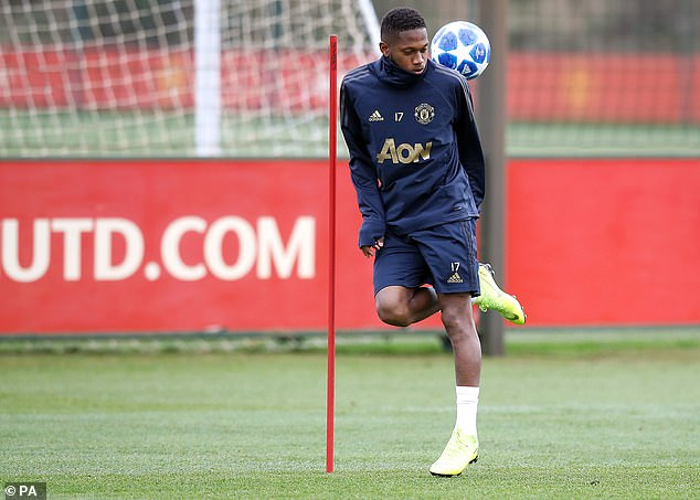 United midfielder Fred warms up as he shows a swift foot in training on Tuesday