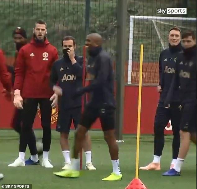 Rashford hides behind goalkeeper David de Gea