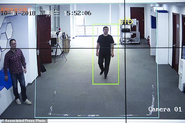 Watrix employees demonstrate the gear recognition software of their company. A Chinese technology startup hopes to start selling software that recognizes people based on their body shape and walking behavior, and enables identification when faces are hidden from cameras