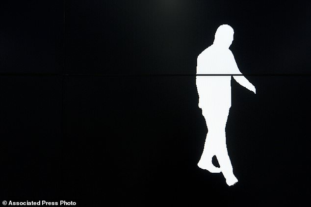A screen shows a computer-generated image of a Watrix employee walking in his company's Beijing offices during a demonstration of his company's motion detection software