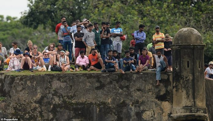 English and Sri Lankan cricket fans enjoyed the view from the walls of Galle Fort on the opening day of the test