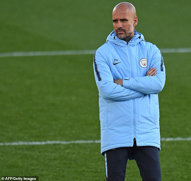 Pep Guardiola watches as his teammates from Manchester City train under his leadership