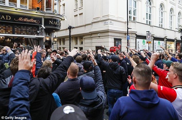 The fans gathered in Covent Garden before their Champions League match against Tottenham