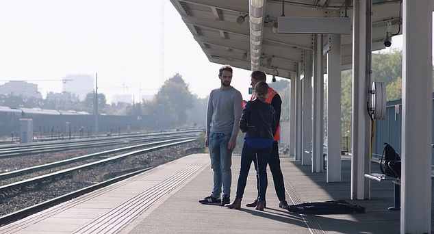 The clip ends with the man being assisted by a trained railway staff