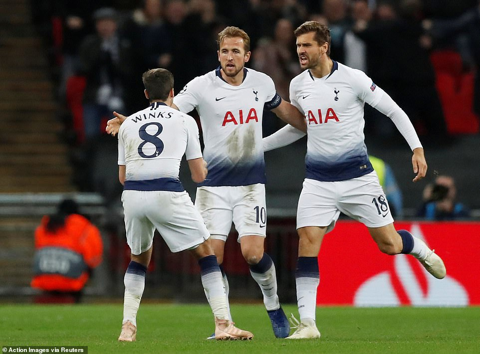 Harry Winks (left) and Fernando Llorente (right) celebrate with the striker after bringing the Spurs back into the game