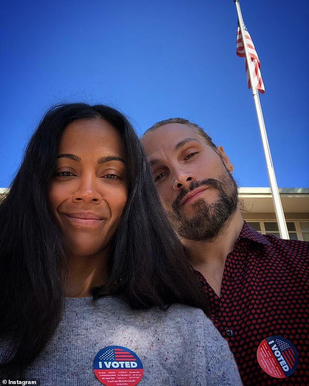 Civic duty: The actress had earlier posted a selfie with husband Marco Perego to Instagram showing them wearing their 'I voted' stickers and standing in front of the polling place