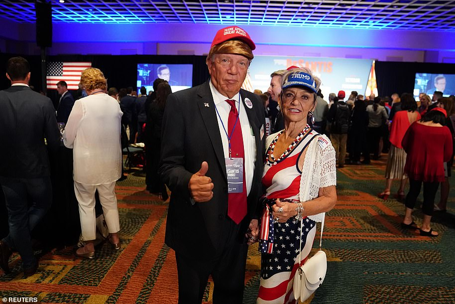A man dressed as Donald Trump lends his support to Florida governor candidate Ron DeSantis, an ally of the President who ultimately won his election against Democrat Andrew Gillum