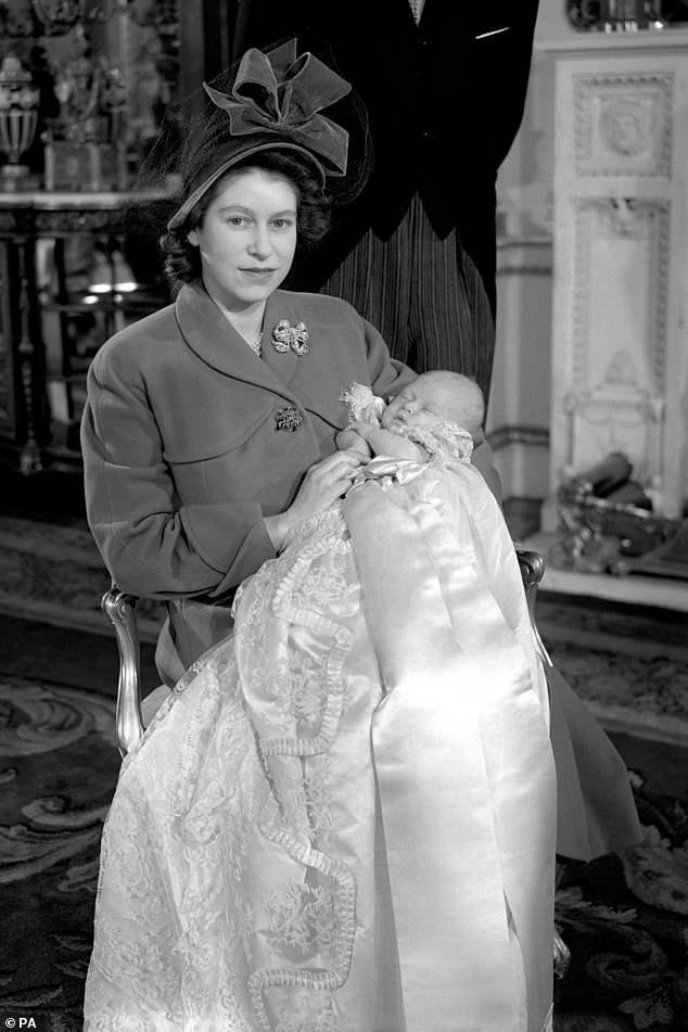 One-month-old Charles is seen with the then Princess Elizabeth after his christening ceremony at Buckingham Palace in 1948