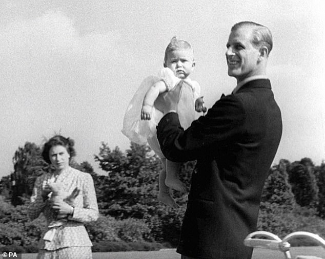 Eight-month-old Charles is pictured with his parents in the grounds of Windlesham Moor, which was the family's country home in Surrey