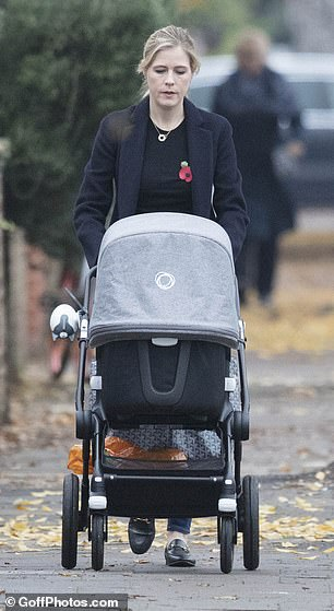 Doting mother: She was seen pushing their little girl in a pram